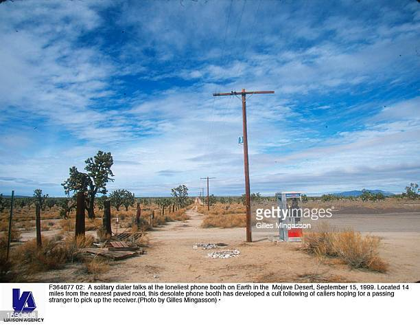 A solitary dialer talks at the loneliest phone booth on Earth in the Mojave Desert September 15 1999 Located 14 miles from the nearest paved road...