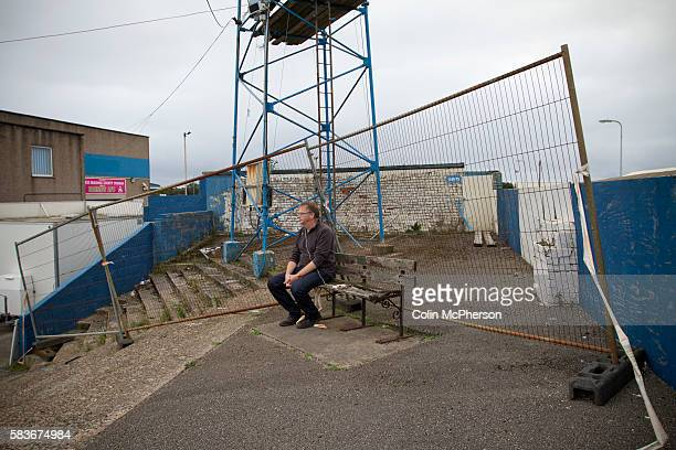 A solitary home supporter watching the action from the terracing at Barrow AFC's Furness Building Society Stadium during the Barrow v Newport County...