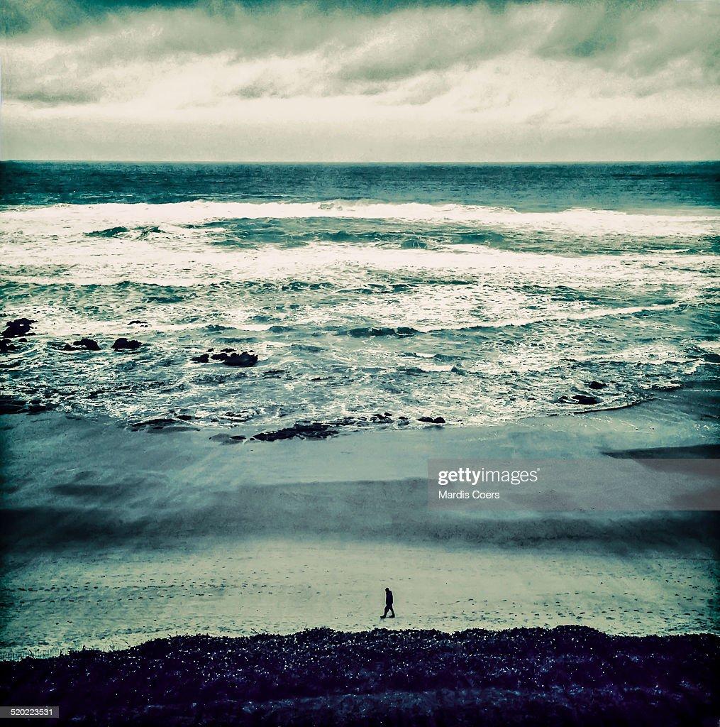 Solitary man on Oregon beach.