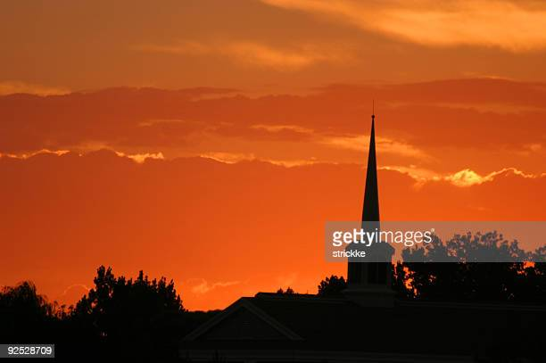 Solitary Silhouetted Steeple Spire Pierces Sunset