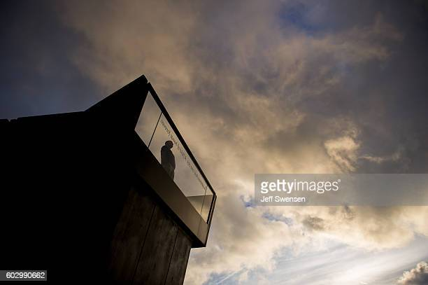 A solitary visitor views the September 11 2016 sunrise from the flight path overlook at the Flight 93 National Memorial before the 15th Anniversary...