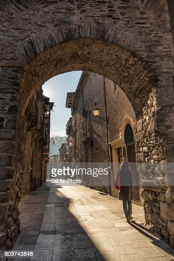 Solitary woman walking in medieval town : Foto stock