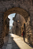 A lonely woman walks in a medieval town in Northern Spain