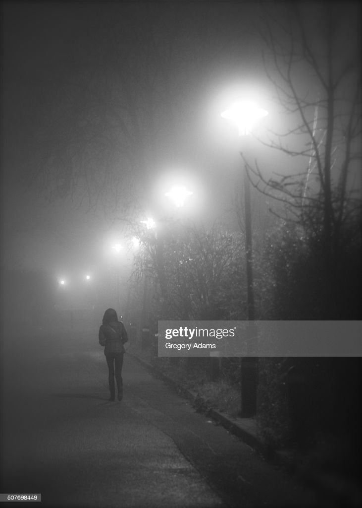 A solitary Woman Walking in the Fog in England