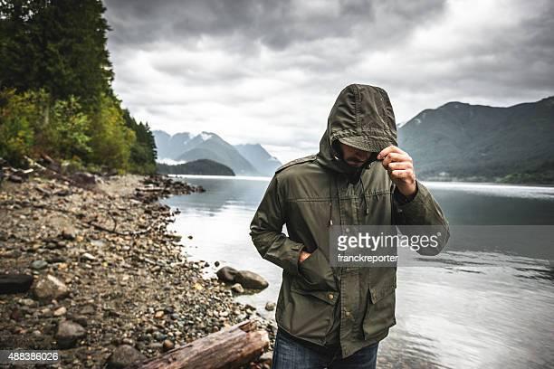 Solitude man sad alone on the lake
