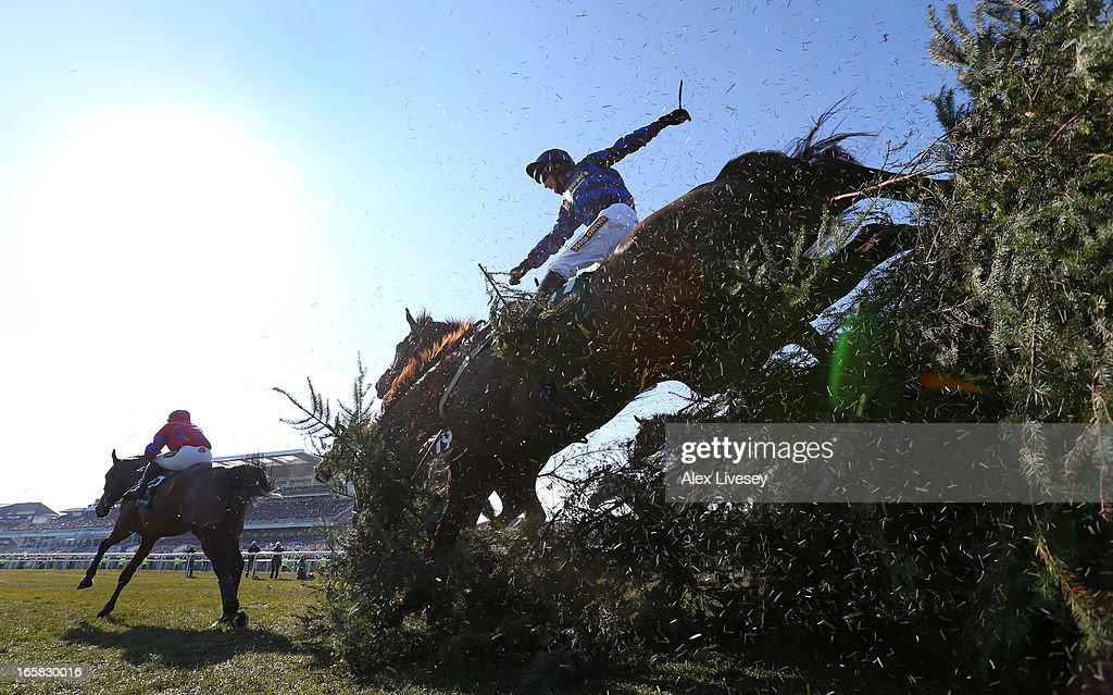 Soll ridden by Mark Grant jumps The Chair during the John Smiths Grand National at Aintree Racecourse on April 6, 2013 in Liverpool, England.