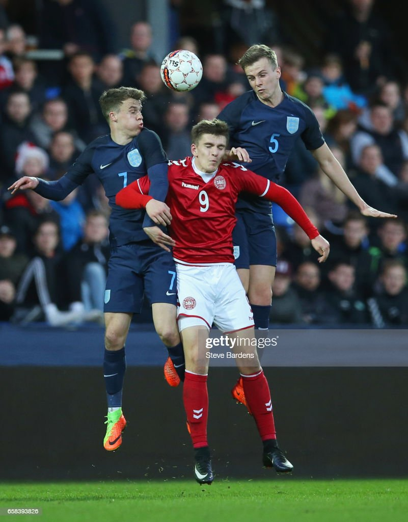 Solly March (7) and Rob Holding of England (5) outjump Mikael Uhre of Denmark during the U21 international friendly match between Denmark and England at BioNutria Park on March 27, 2017 in Randers, Denmark.