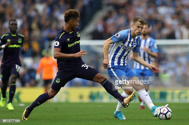 Solly March of Brighton and Hove Albion and Mason Holgate of Everton in action during the Premier League match between Brighton and Hove Albion and...