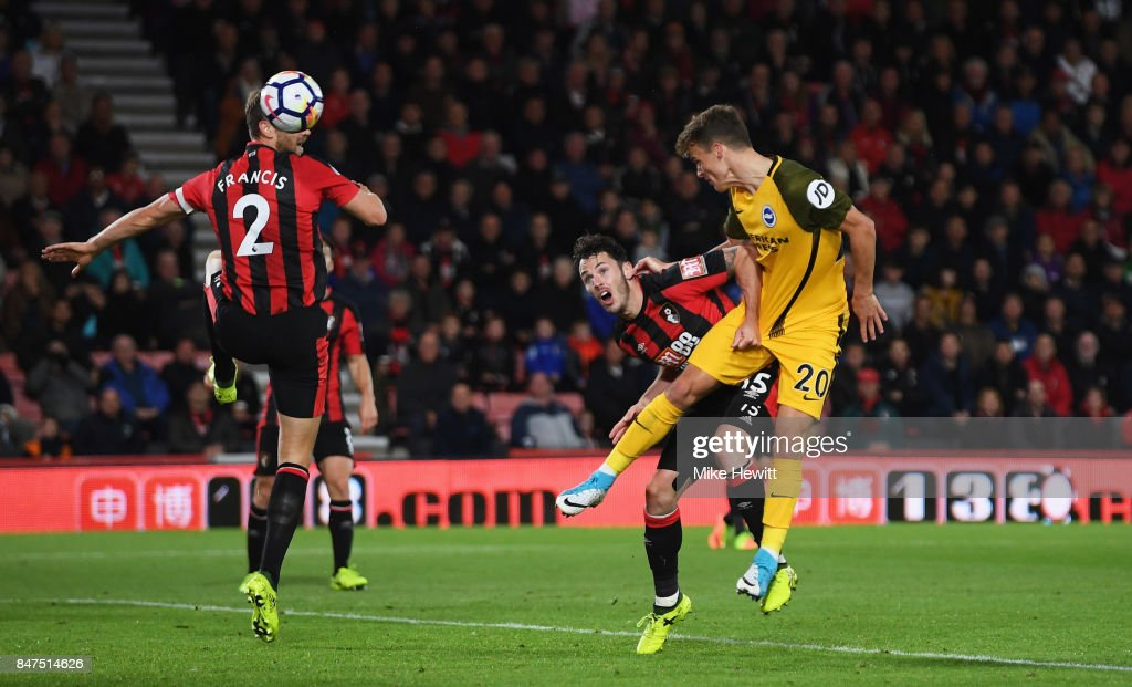 Solly March of Brighton and Hove Albion (20) beats Adam Smith of AFC Bournemouth (15) to score their first goal during the Premier League match between AFC Bournemouth and Brighton and Hove Albion at Vitality Stadium on September 15, 2017 in Bournemouth, England.