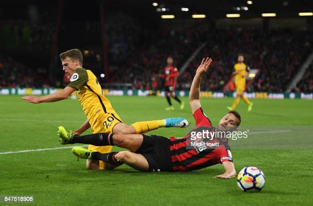 Solly March of Brighton and Hove Albion is tackled by Simon Francis of AFC Bournemouth during the Premier League match between AFC Bournemouth and...