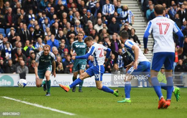 Solly March of Brighton and Hove Albion scores his team's second goal during the Sky Bet Championship match between Brighton and Hove Albion and...