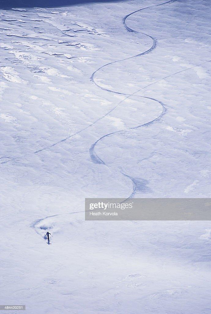 Solo backcountry skier makes tracks down.