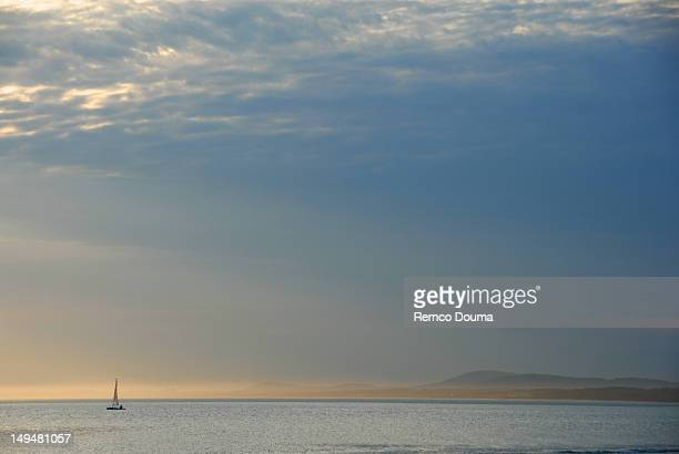 Solo catamaran sailing in distance