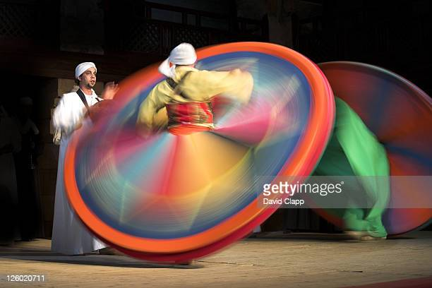 Solo drummer and two Sufi Dancers, Cairo, Egypt