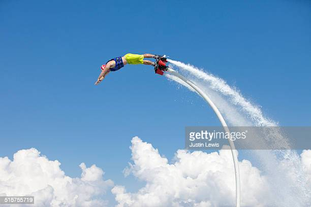 Solo Guy Airboarding, Blue Sky Background