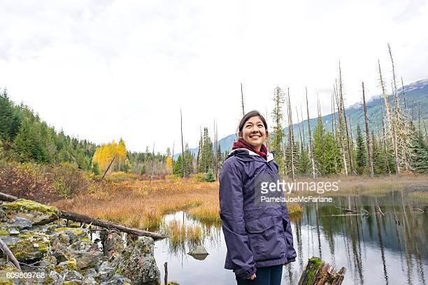 Solo, Independent Young Woman Hiking in Mountain Wilderness Autumn Forest