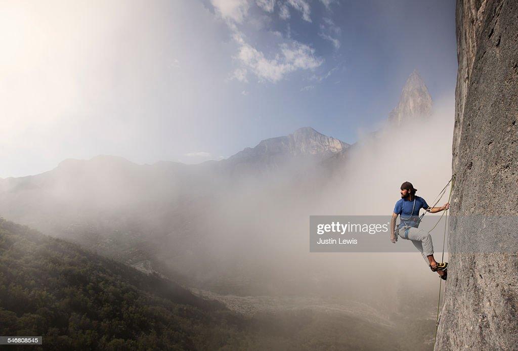 Solo Man Climbs Rock Wall : Stock Photo