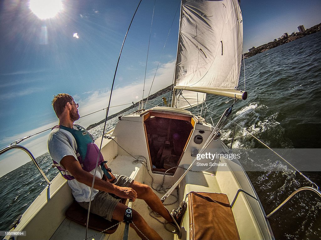 Solo sailing Great Slave Lake, NT : Stock Photo