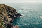 Solo traveler on the rocky sea side , North Spain , The Bay of Biscay
