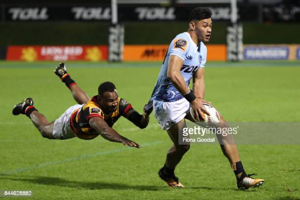 Solomon Alaimalo of Northland is tackled by Illisea Ratuva Tavuyara of Waikato during the round four Mitre 10 Cup match between Northland and Waikato...