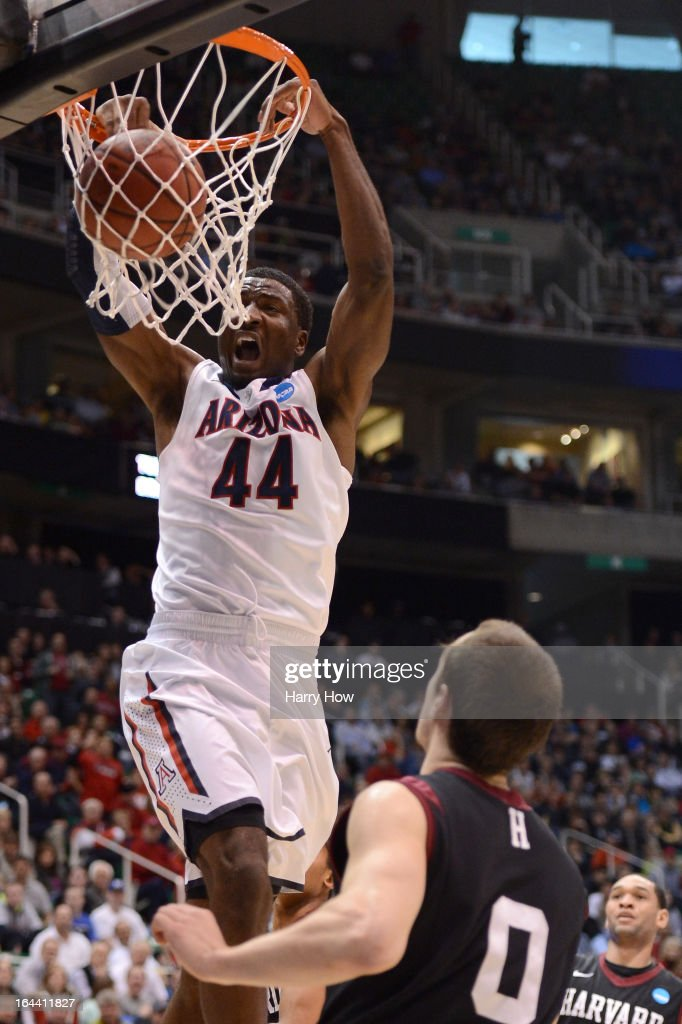 Solomon Hill #44 of the Arizona Wildcats dunks the ball over Laurent Rivard #0 of the Harvard Crimson in the first half during the third round of the 2013 NCAA Men's Basketball Tournament at EnergySolutions Arena on March 23, 2013 in Salt Lake City, Utah.