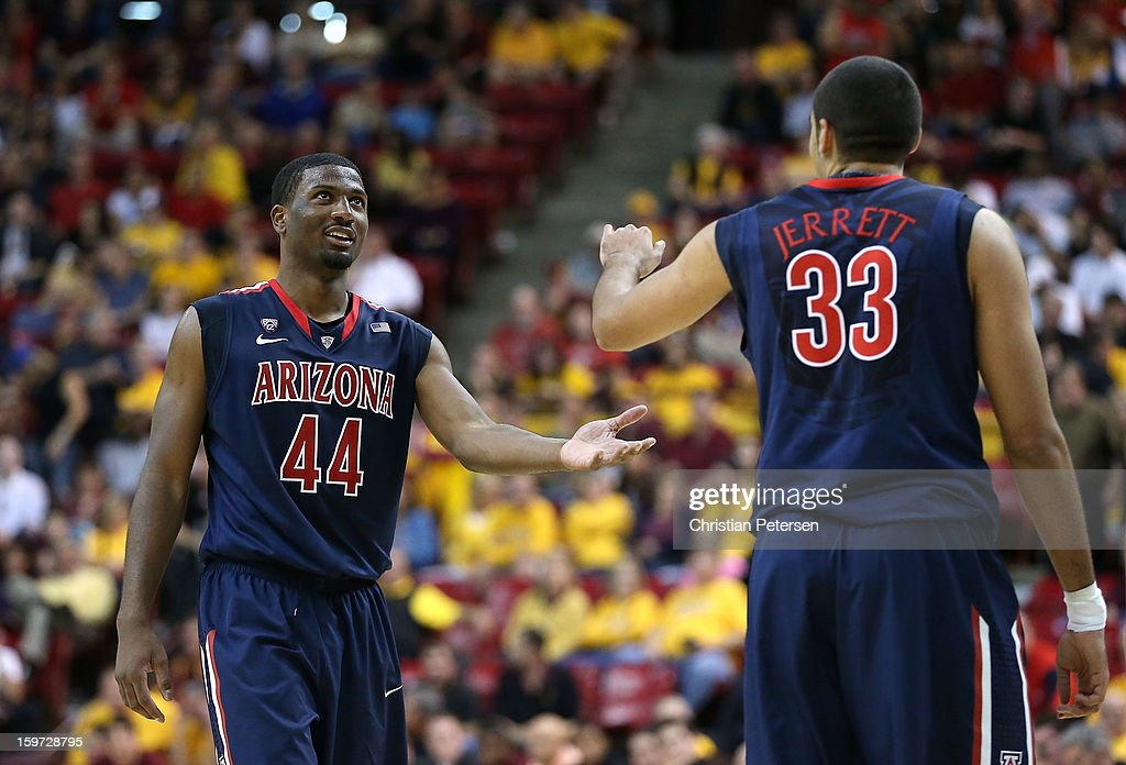 Solomon Hill #44 of the Arizona Wildcats high-fives Grant Jerrett #33 after scoring against the Arizona State Sun Devils during the college basketball game at Wells Fargo Arena on January 19, 2013 in Tempe, Arizona. The Wildcats defeated the Sun Devils 71-54.