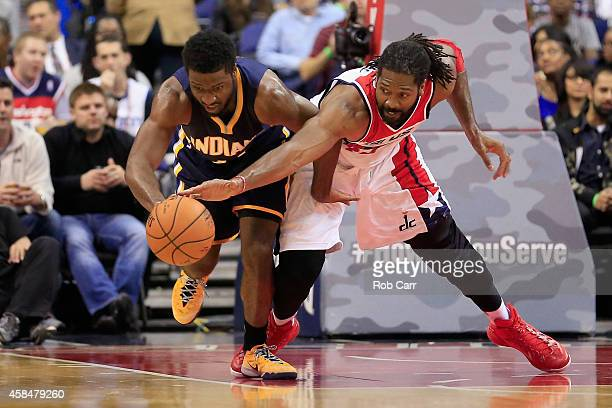 Solomon Hill of the Indiana Pacers and Nene Hilario of the Washington Wizards go after a loose ball during the first half at Verizon Center on...