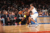Solomon Hill of the Indiana Pacers drives to the basket against Lance Thomas of the New York Knicks on April 8 2015 at Madison Square Garden in New...