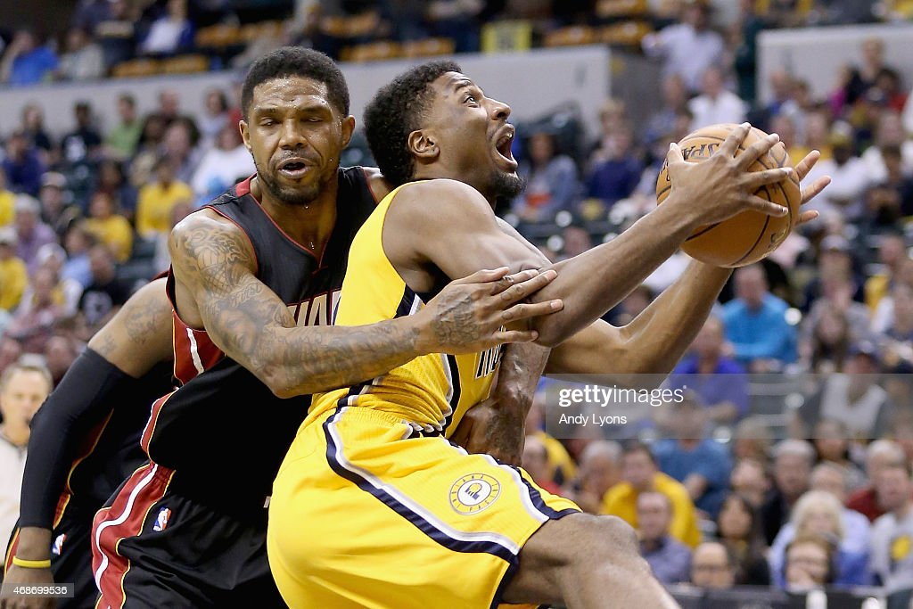 Solomon Hill of the Indiana Pacers is fouled by Udonis Haslem of the Miami Heat at Bankers Life Fieldhouse on April 5 2015 in Indianapolis Indiana...