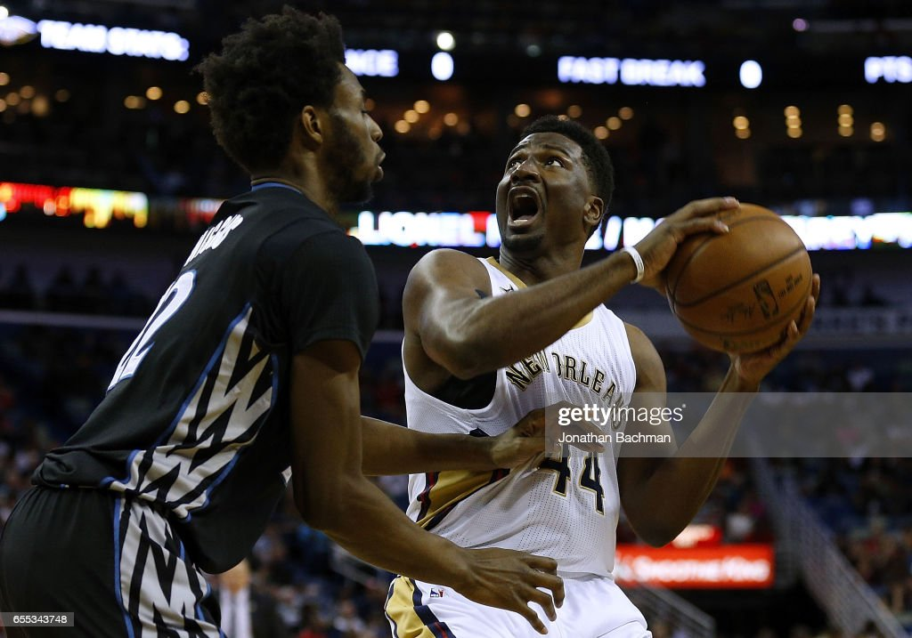 Solomon Hill #44 of the New Orleans Pelicans drives against Andrew Wiggins #22 of the Minnesota Timberwolves during the first half of a game at the Smoothie King Center on March 19, 2017 in New Orleans, Louisiana.