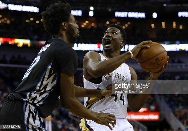 Solomon Hill of the New Orleans Pelicans drives against Andrew Wiggins of the Minnesota Timberwolves during the first half of a game at the Smoothie...