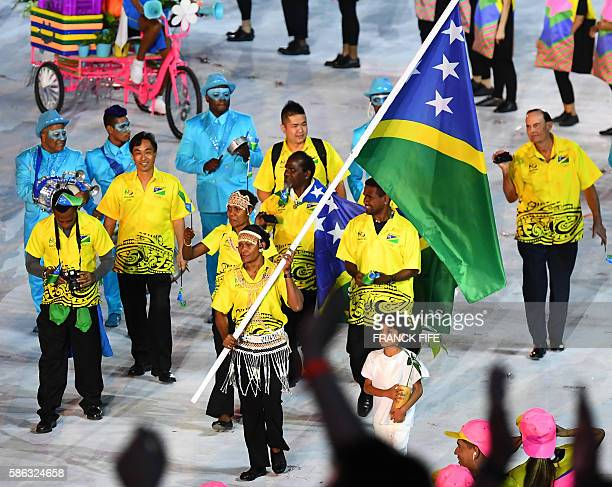 Solomon Islands' flag bearer Jenly Wini leads her national delegation during the opening ceremony of the Rio 2016 Olympic Games at the Maracana...