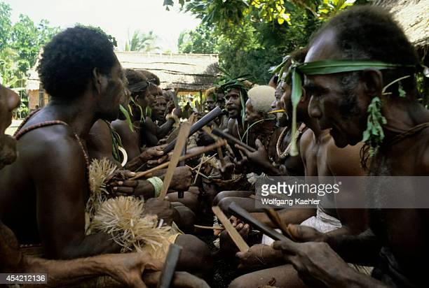 Solomon Islands Malaita Tribal Male Band Playing Traditional Wooden Instruments