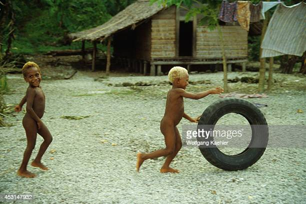 Solomon Islands Nendo Island Native Boys Playing With Tire