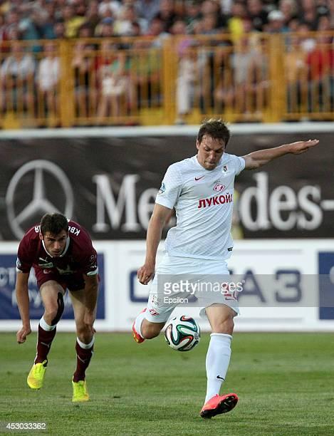 Solomon Kvirkvelia of FC Rubin Kazan is challenged by Artem Dzuba of FC Spartak Moscow during the Russian Football League Championship match between...