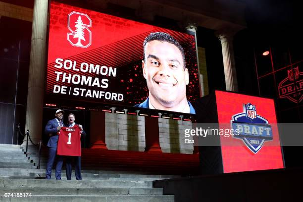 Solomon Thomas of Stanford poses with Commissioner of the National Football League Roger Goodell after being picked overall by the San Francisco...