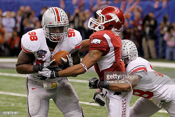 Solomon Thomas of the Ohio State Buckeyes intercepts a pass as he is tackled by Jarius Wright of the Arkansas Razorbacks to seal the 3126 victory for...