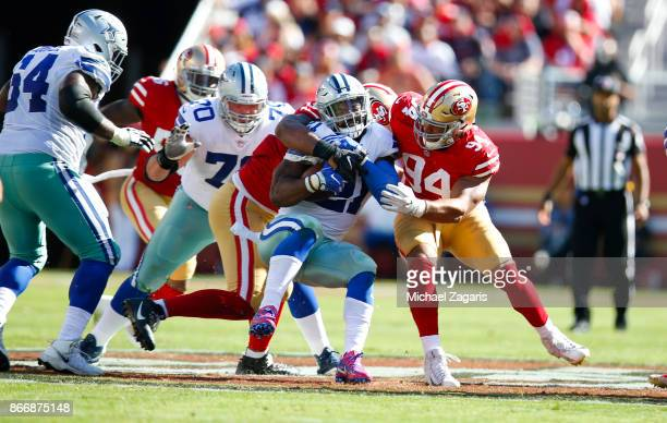 Solomon Thomas of the San Francisco 49ers tackles Ezekiel Elliott of the Dallas Cowboys during the game at Levi's Stadium on October 22 2017 in Santa...