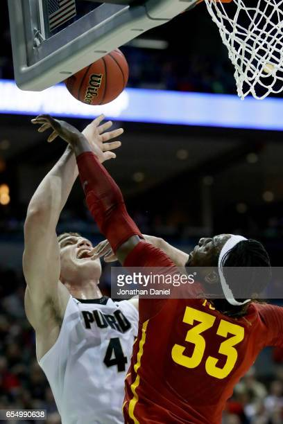 Solomon Young of the Iowa State Cyclones blocks a shot attempt by Isaac Haas of the Purdue Boilermakers in the first half during the second round of...