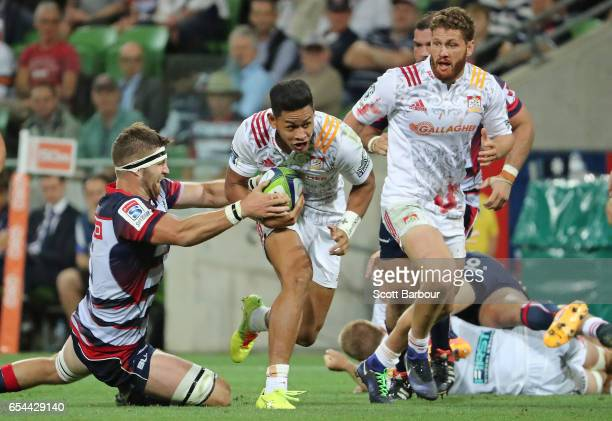 Solomona Alaimalo of the Chiefs runs with the ball during the round four Super Rugby match between the Rebels and the Chiefs at AAMI Park on March 17...