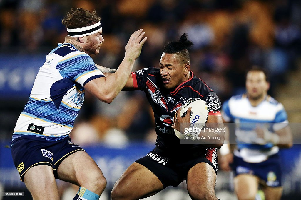 Solomone Kata of the Warriors fends against Chris McQueen of the Titans during the round 17 NRL match between the New Zealand Warriors and the Gold Coast Titans at Mt Smart Stadium on July 2, 2016 in Auckland, New Zealand.
