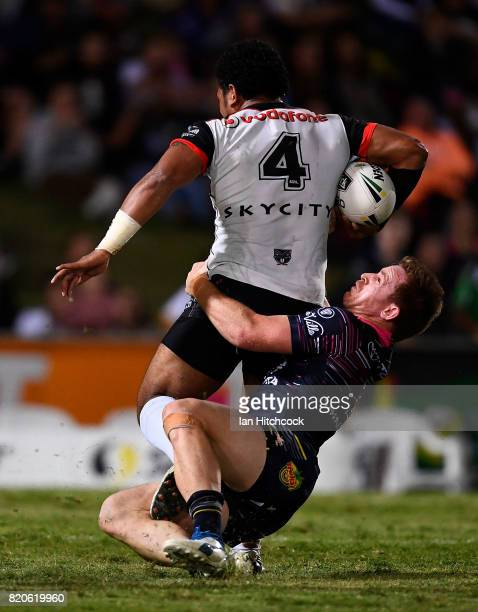 Solomone Kata of the Warriors is tackled by Michael Morgan of the Cowboys during the round 20 NRL match between the North Queensland Cowboys and the...