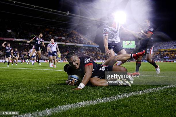 Solomone Kata of the Warriors scores a try during the round 14 NRL match between the New Zealand Warriors and the Sydney Roosters at Mt Smart Stadium...