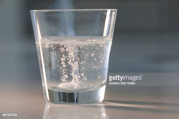 soluble tablet dissolving in a tumbler of water