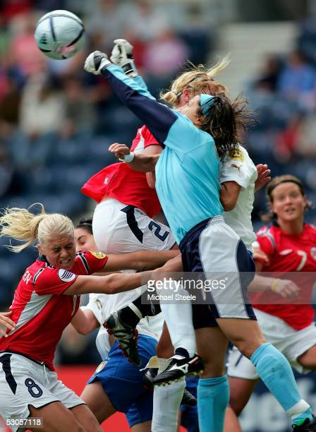 Solveig Gulbrandsen and Lise Klavenesss of Norway lose out to a punched clearance by Carla Brunozzi of Italy during the Women's UEFA European...