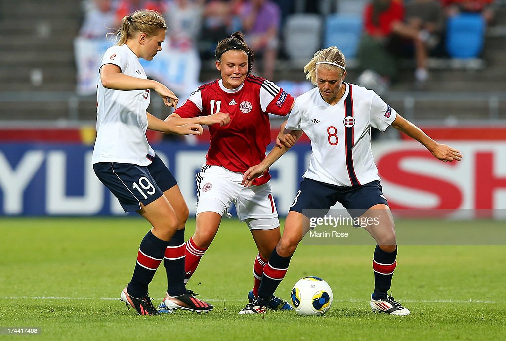Solveig Gulbrandsen (R) of Norway and Katrine Veje (C) of Denmark battle for the ball during the UEFA Women's Euro 2013 semi final match between Norway and Denmark at Nya Parken on July 25, 2013 in Norrkoping, Sweden.