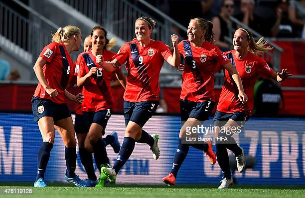 Solveig Gulbrandsen of Norway celebrates with team mates after scoring her teams first goal during the FIFA Women's World Cup 2015 Round of 16 match...