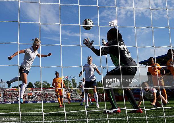 Solveig Gulbrandsen of Norway scores in the second half as Cynthia Djohore of Ivory Coast is unable to make the save in the second half during the...