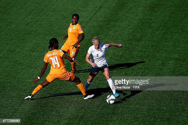 Solveig Gulbrandsen of Norway takes the ball past Josee Nahi of Cote D'Ivoire during the FIFA Women's World Cup 2015 Group B match between Cote...
