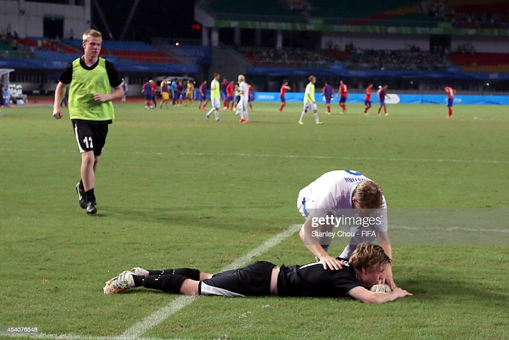 Solvi Bjornsson of Iceland is consoled by a team-mate after the defeat to Korea Republic by 3 goals to 1 in the penalty shoot out after full time 1-1 draw during the 2014 FIFA Boys Summer Youth Olympic Football Tournament Semi Final match between Korea Republic and Iceland at Jiangning Sports Centre Stadium on August 24, 2014 in Nanjing, China.